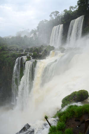 americal: Iguazu waterfall in south americal tropical jungle with a massive flow of water Stock Photo