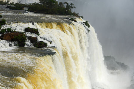massive: a massive flow of water at Iguazu waterfall
