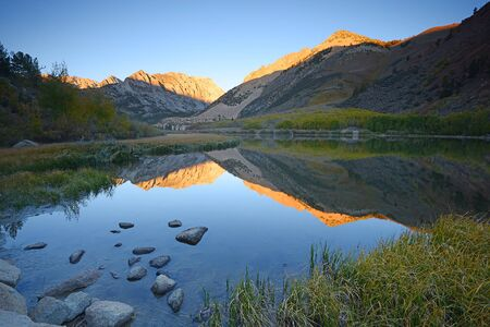 high sierra: morning sunlight over mountain behind north lake at sierra nevada range