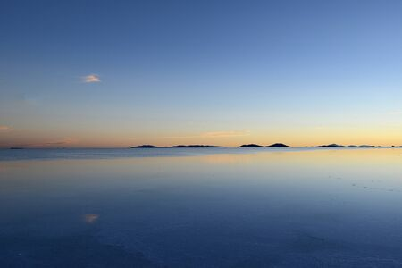 salt flat: reflection over a pond in uyuni salt flat in bolivia Stock Photo