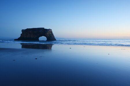 natural bridge: natural bridge in the sea at Santa Cruz, California