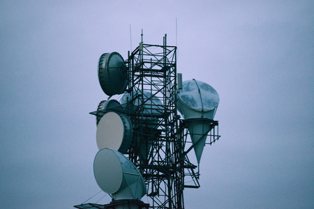 radio antenna tower with blue sky of evening twilight