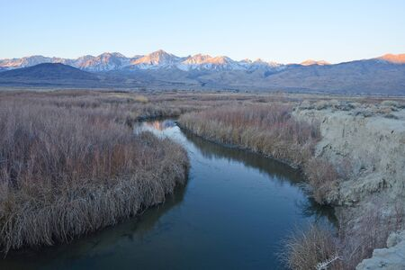 sierra nevada mountain range: river bend with mountain peaks of sierra nevada mountain range near big pine california