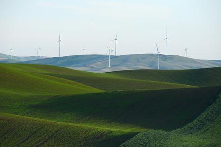 palouse: Wind mill on green wheat farm hill in palouse, washington