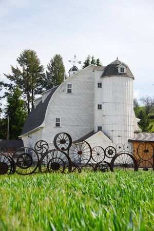 palouse: the famous wheel fence with artisan barn in palouse, washington
