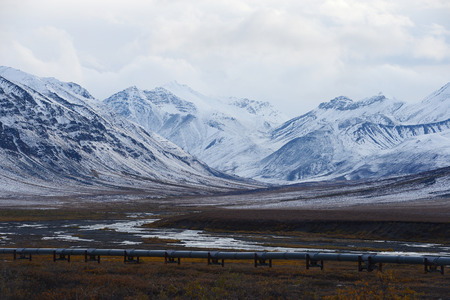 pipeline: oil pipeline with mountain in northern alaska
