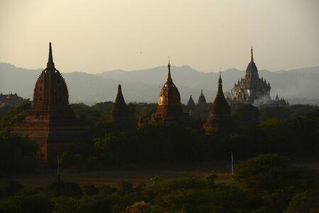 bagan: pagodas in bagan at sunset