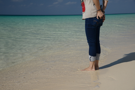 a lady in water at maehama beach, okinawa