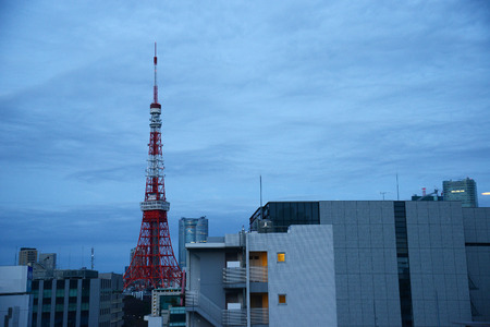 tokyo tower with cloudy sky
