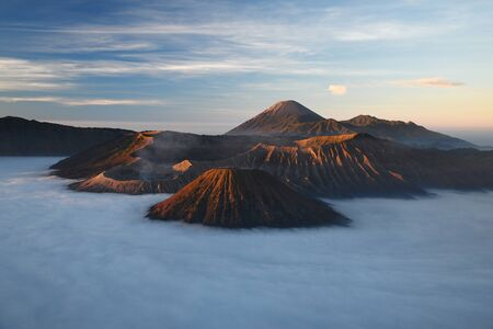 Bromo mountain with fog layer at sunrise, East Java, Indonesia Stock Photo - 137698808
