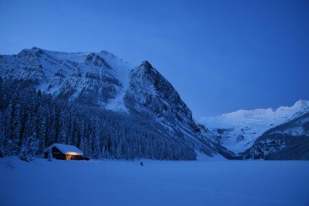 Lake Louise sunrise in Winter surrounded with snow