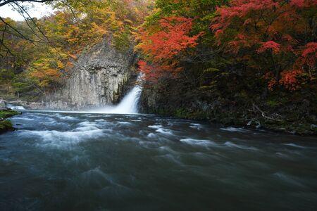 Waterfall stream in Tohoku with Autumn Colors near Lake Towada, Japan