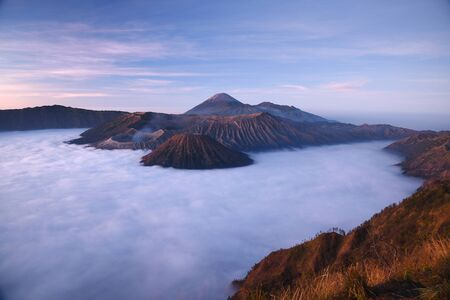 Bromo mountain with fog layer at sunrise, East Java, Indonesia Stock Photo