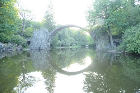 Rakotzbrucke Devil Bridge in a local park in Germany