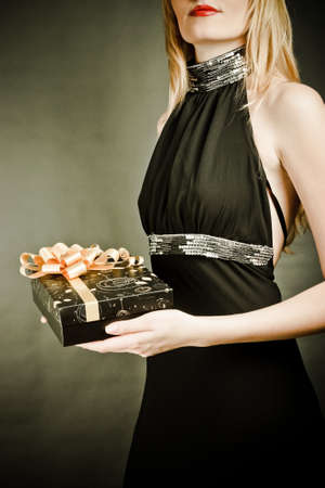sexy girl holding a gift in magic packing Stock Photo - 11322102