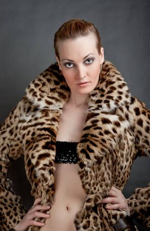 Portrait of a beautiful young woman in a fur. Stock Photo - 11322101