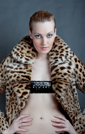 Portrait of sexy female in fashionable coat photo