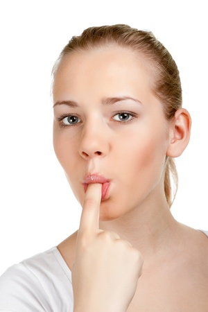portrait of a young woman with finger in mouth Stock Photo - 11322188