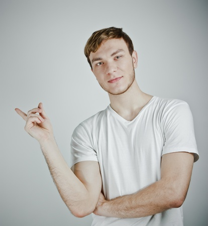 Man pointing showing photo