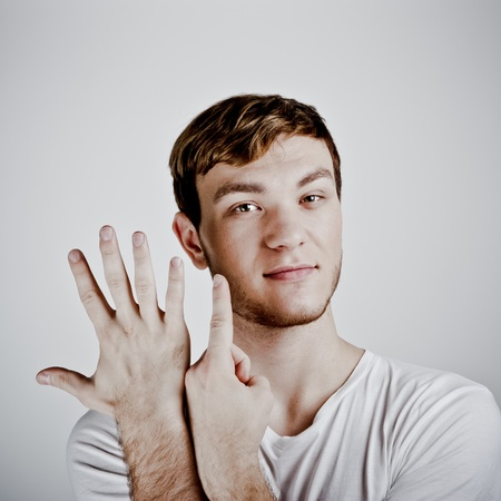 young  man holding up six fingers Stock Photo - 11322146