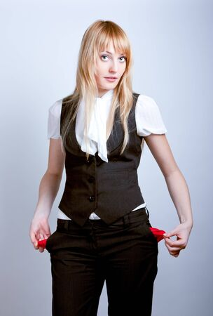 Young business woman showing empty pockets photo