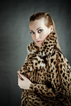 Attractive woman in fur coat photo