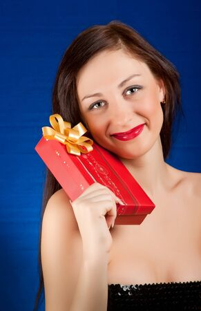 Young smiling woman holding gift Stock Photo - 11322213