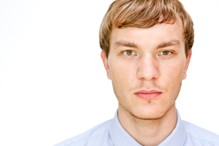 man face close up: Portrait of a confident young man isolated against white background Stock Photo