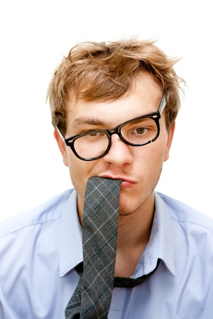 tired businessman with a tie in the mouth photo