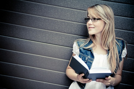 reading glasses: beautiful girl reading a book Stock Photo