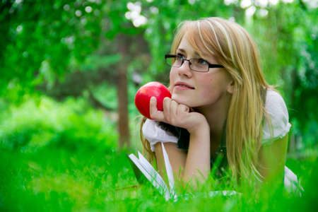 beautiful girl in the park reading a book Stock Photo - 11322512