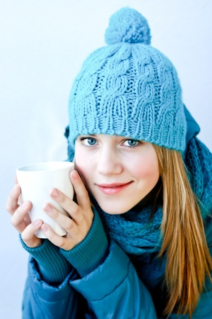 seasonal clothes: girl with a cup of hot tea Stock Photo