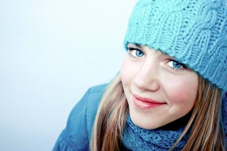 Beautiful girl in winter clothes photo