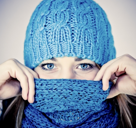 beautiful girl with a scarf hiding photo