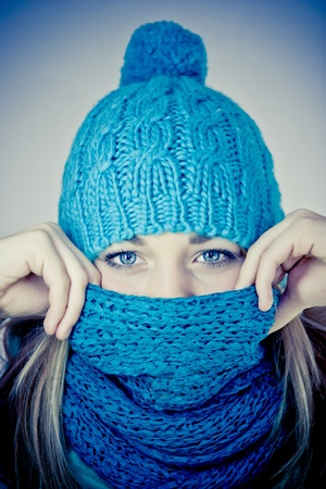winter jacket: beautiful girl with a scarf hiding