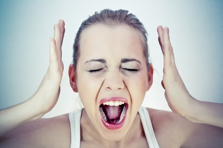 mouth  open: Screaming woman Stock Photo