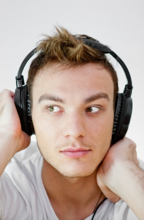 Young man with headphones photo