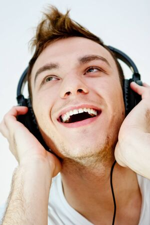 young man enjoying music photo