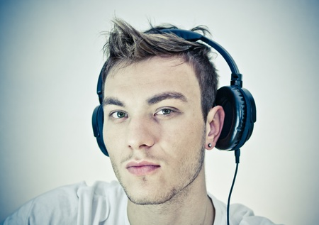 Portrait of a happy young man listen music with headphones photo
