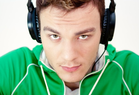 Portrait of a young man listen music with headphones photo