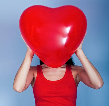 Valentine's day. Beautiful woman with heart in his hands Stock Photo - 12390400