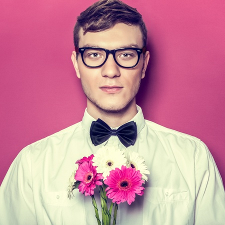 constraining: Young beautiful man with flowers