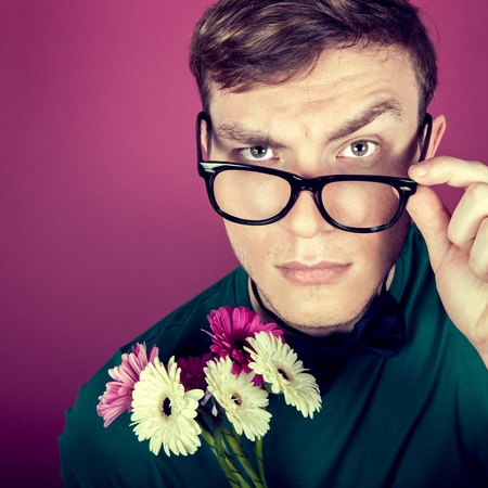 constraining: image of a man in big glasses with flowers Stock Photo