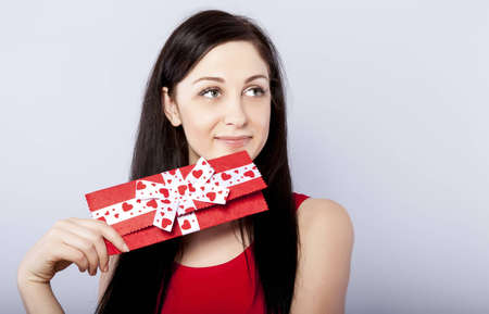 Beautiful woman with present photo