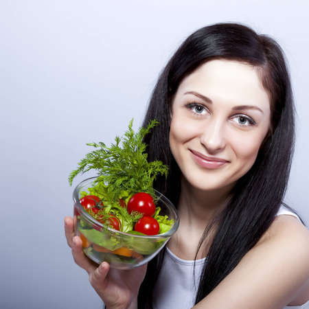 Young smiling woman with  vegetables. photo