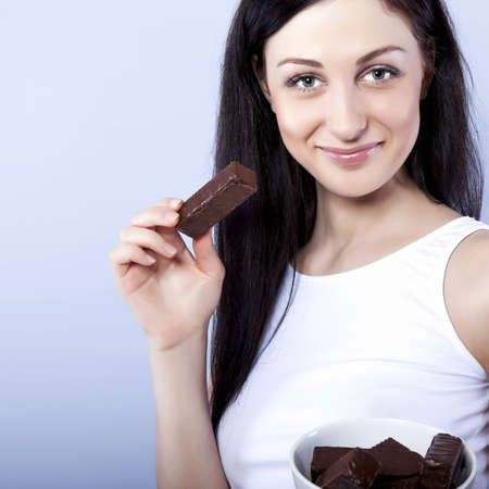 craving: portrait of beautiful woman with a chocolate