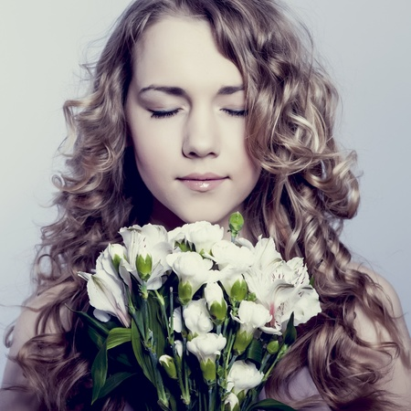 Portrait of beautiful young woman  with flower photo