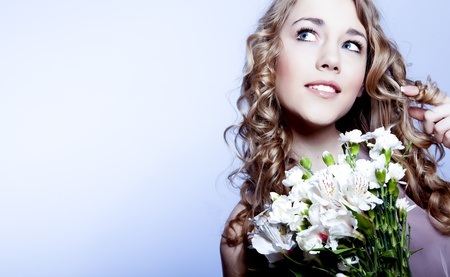 Portrait of beautiful young woman  with flower Stock Photo - 12534725