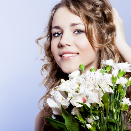 Happy young smiling woman with flowers Stock Photo - 12536358