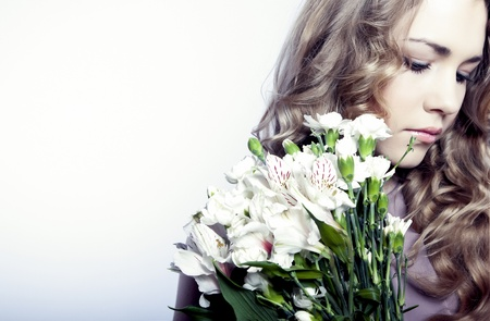 Beautiful young woman with flowers Stock Photo - 12536390
